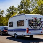 Caravan trailer on a freeway road.