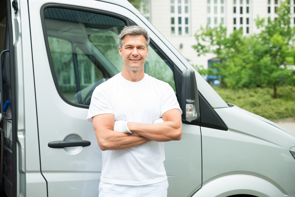 An image of a man with a van